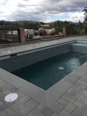 Gray Charcoal Pool Deck with Precast Coping