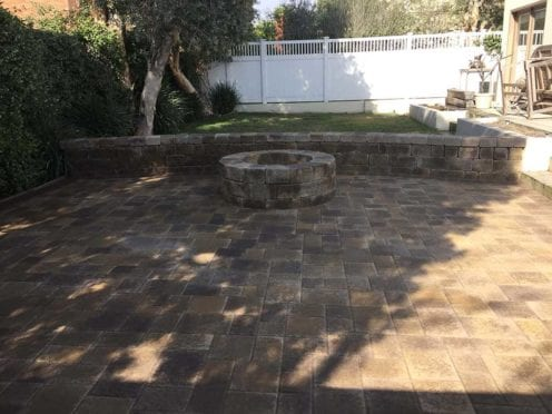 Semicircular Bench with a Round Fire Pit constructed with Angelus Courtyard Pavers, Sand Stone Mocha Color