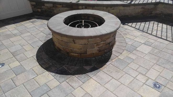 Round Fire Pit Constructed with Angelus Courtyard Pavers, 50/50 Mix Sand Stone Mocha and Cream Brown Charcoal Mix